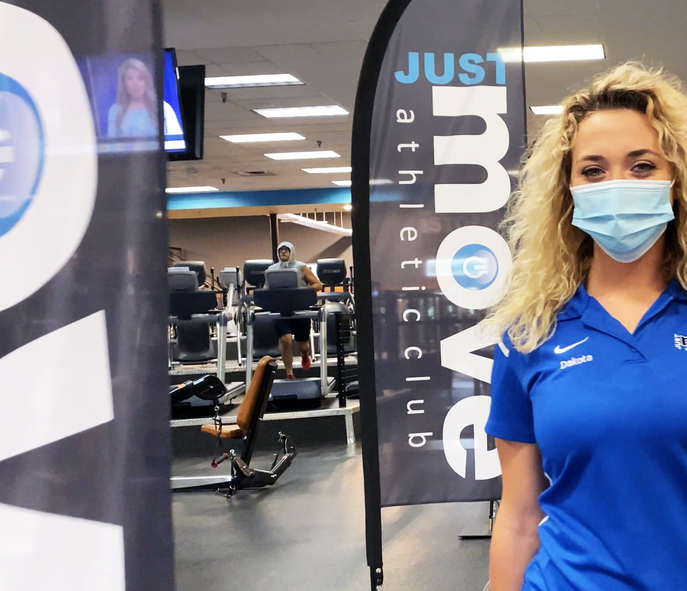 Woman wearing a mask at just move.